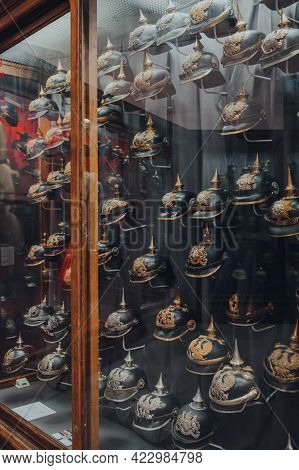 Brussels, Belgium - August 17, 2019: Variety Of Military Helmets On Exhibit In The Royal Museum Of T