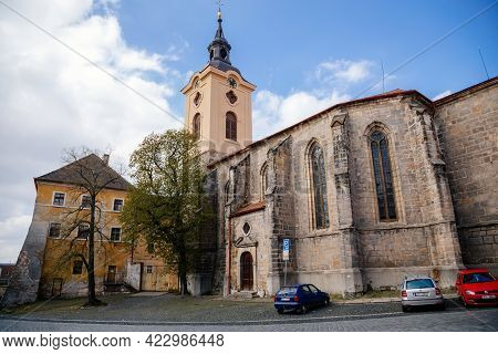 Medieval Gothic Church Of St. Ignatius Of Loyola With Baroque Tower In Sunny Day, Historical Center,