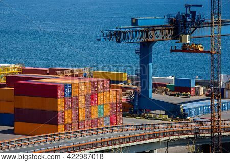 Cargo Seaport With A Warehouse Of Multicolored Containers Exported By Sea Logistics Of Goods And Loa