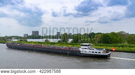 Amsterdam, Netherlands - 19 May, 2021: Large Riverboat Barge Tranporting Goods Along The Wide Canals