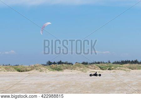 Kite Buggy Enjoying A Windy Day On The Wadden Sea Island Beaches Of Western Denmark
