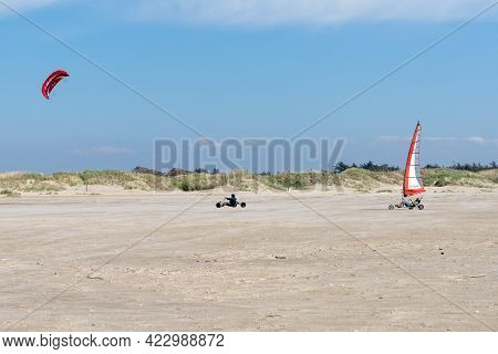 Kite Buggy And Blokart Wind Buggy Enjoying A Windy Day On The Wadden Sea Island Beaches Of Western D