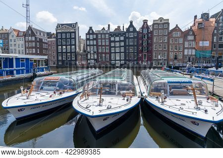 View Of The Iconic Houses On The Waterfront At The Damrak In Downtown Amsterdam With City Tour Touri