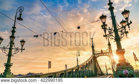 Cloudy Sunrise Over Liberty Bridge In Budapest, Hungary