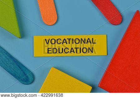 Top View Of Colorful Wooden Blocks And Memo Note Written With Vocational Education