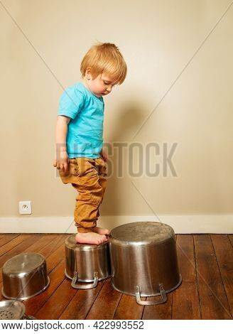 Toddler Boy Play With Kitchenware Climb On Pans