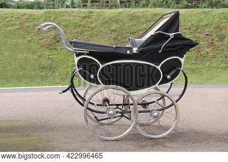 A Four Wheeled Traditional Vintage Baby Pram.