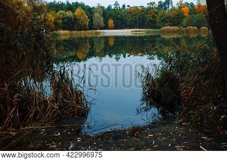 Early Autumn Scenery With Lake. Natural Lake Scenery During Autumn Fall Season With Colorful Trees.