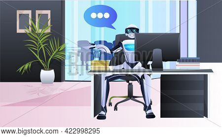 Robotic Businessperson Sitting At Workplace In Office Chat Bubble Communication Artificial Intellige