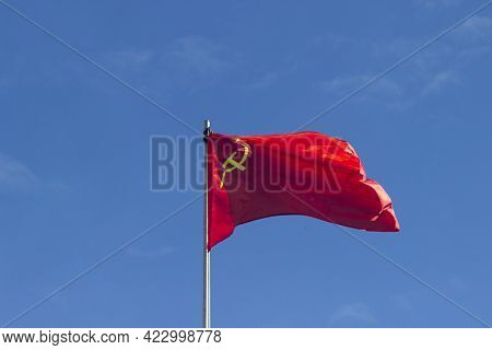 The Red Flag Of The Ussr With A Hammer And Sickle Fluttering In The Wind