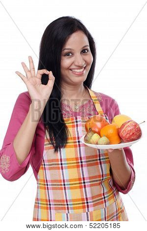 Young Happy Smiling Woman With Plate Of Fruits