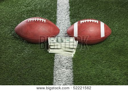 Pro and college style footballs with a pile of money on the line poster