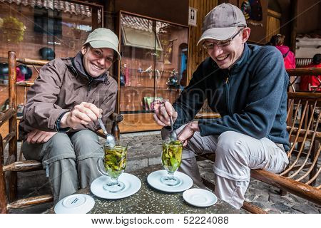 PISAC, PERU - JULY 14: Tourists drinking coca tea in the peruvian Andes at Pisac Peru on july 14th, 2013. Coca tea is a tisane made using the leaves of the coca plant, which is native to South America