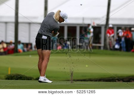 KUALA LUMPUR - OCTOBER 13: Suzann Pettersen of Norway chips the ball to the 2nd hole green of the KLGCC course on the final day of the Sime Darby LPGA on October 13, 2013 in Kuala Lumpur, Malaysia.