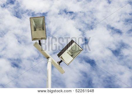 Lamppost  On Cloud Sky