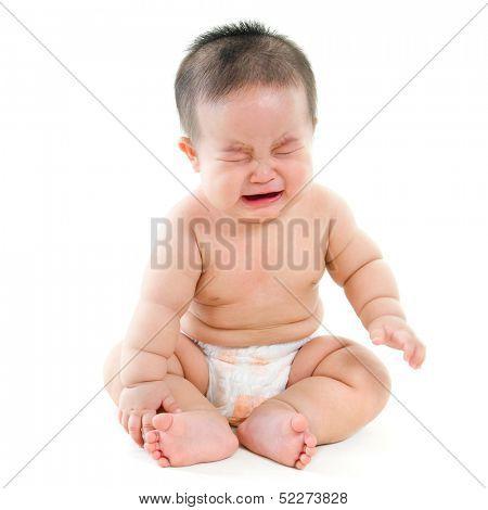 Full body hungry Asian baby boy crying, sitting isolated on white background