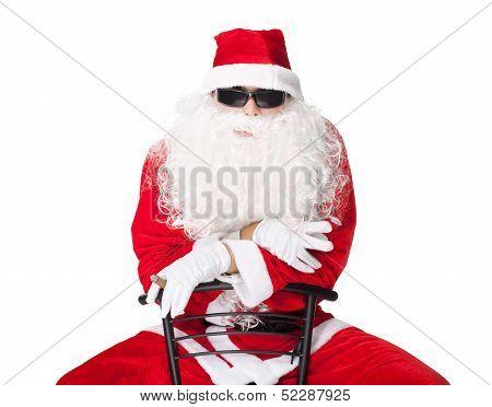 Santa Claus Wearing Sunglasses And Smoking A Cigar