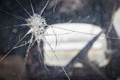 Abstract Cracked Window Glass on Antique Truck with Selective Focus.  poster
