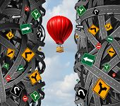 Innovative leadership with a businessman in a hot air balloon flying upward and escaping the confusion of tangled roads and confusing traffic signs as a concept and metaphor for ignoring obstacles and overcoming adversity. poster
