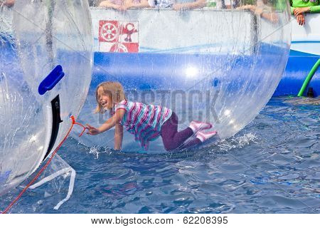 Girls And Boys Have Fun In A Huge Zorbing Ball