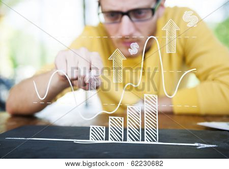 Contemporary Businessman Studying a Graph