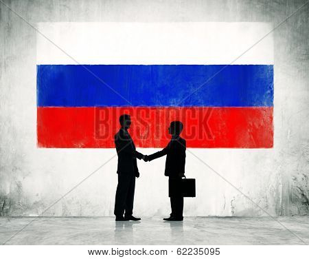 Business Handshake With Flag of Russia