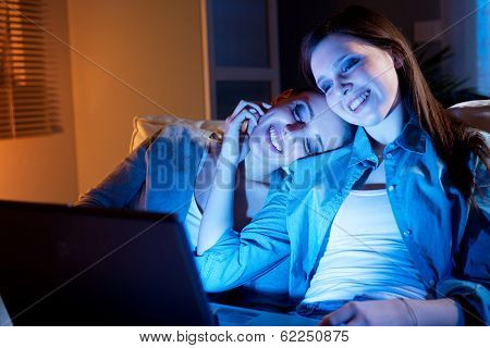 Girlfriends On A Sofa With Laptop