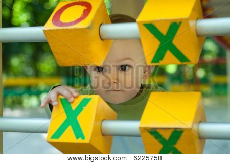 Little Boy On Playground