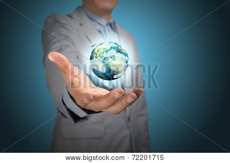 Business male hand hold eafth globe on blue background