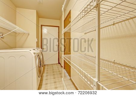 Empty Laundry Area With Mobile Racks