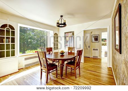 Dining Area With Round Wooden Table
