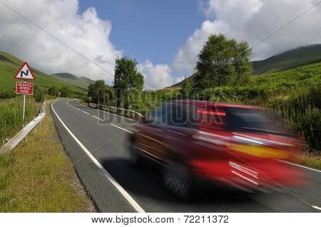 Red Car On Mountain Road