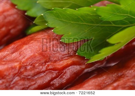 Group Of Tasty Sausages With Parsley