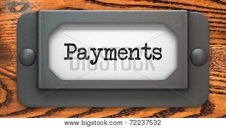 Payments - Inscription on File Drawer Label on a Wooden Background. poster