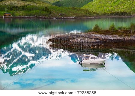 Small fishing boat in scenic fjord on Lofoten, Norway