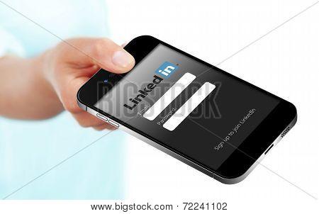 Gdansk - Poland, September 19, 2014. Hand Holding Smart Phone With Linkedin Login Page.