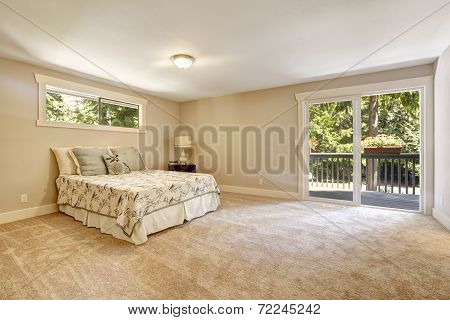 Spacious Bedroom Interior With Walkout Deck