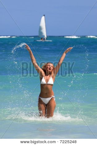 Happy Woman Playing In Water In The Caribbean