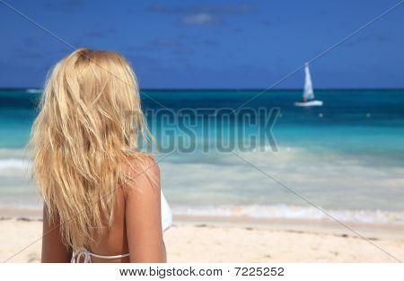 Young Woman In Bikini Enjoying The Day At The Caribbean Beach
