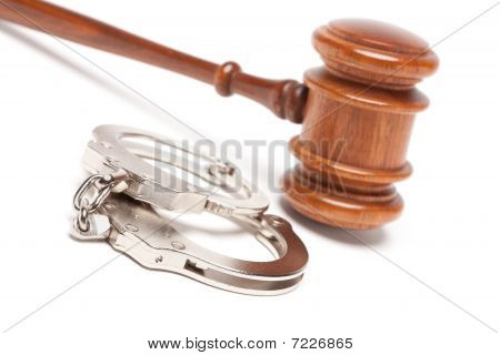 Gavel And Handcuffs On White