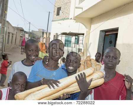 Unidentified children (bread delivery boys)