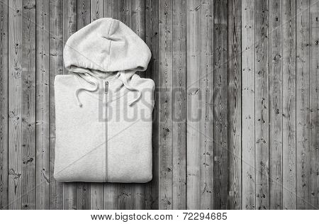 White Hoodie On Dark Wood Background