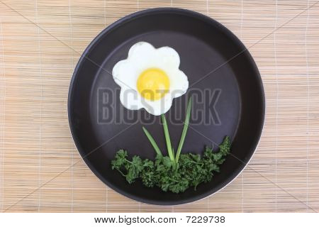 Flower Shaped Fried Egg With Greenery