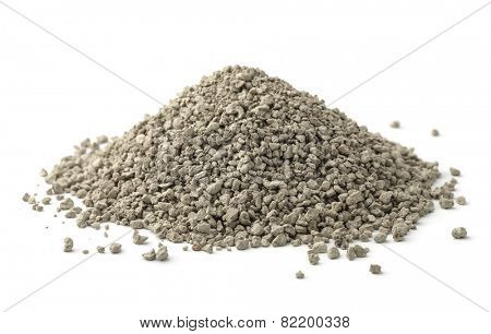 Pile of clumping cat litter isolated on white