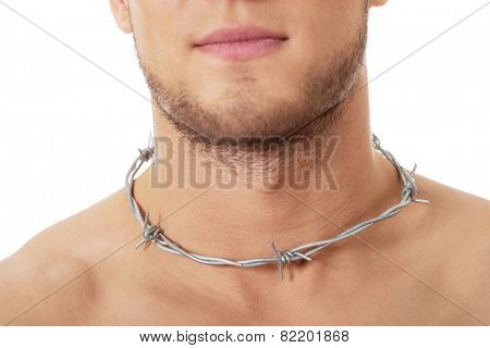Handsome man with spikes around neck. Throat pain concept.