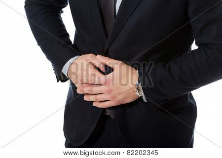 Young handsome businessman suffering from stomach pain.