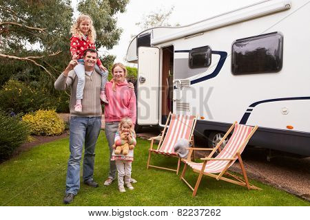 Family Enjoying Camping Holiday In Camper Van