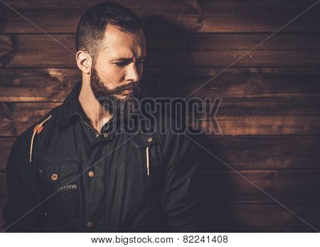 Handsome man with beard  wearing waxed canvas jacket  poster