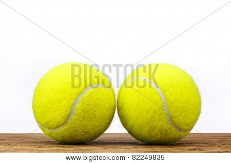 Two Tennis Balls Table Wood Isolated