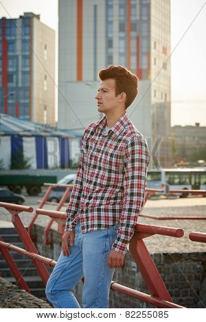 Handsome man outdoors over urban background
